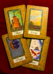 From left, top: Tower; Clouds; Moon; Fox — all of these cards have completely different meanings from Lenormand